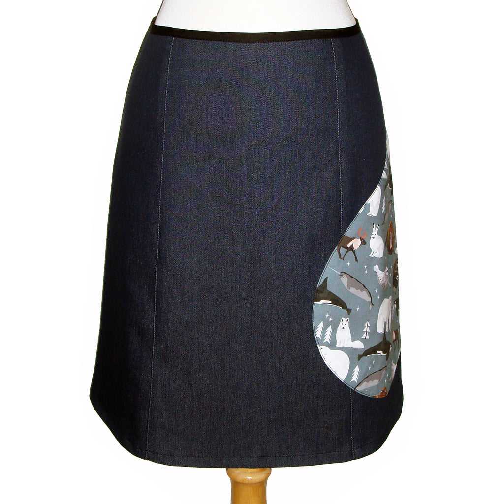 dark denim knee length skirt with teardrop side patch featuring narwhal, polar bear, killer whale, walrus, seal, muskox, arctic hare, caribou, arctic fox