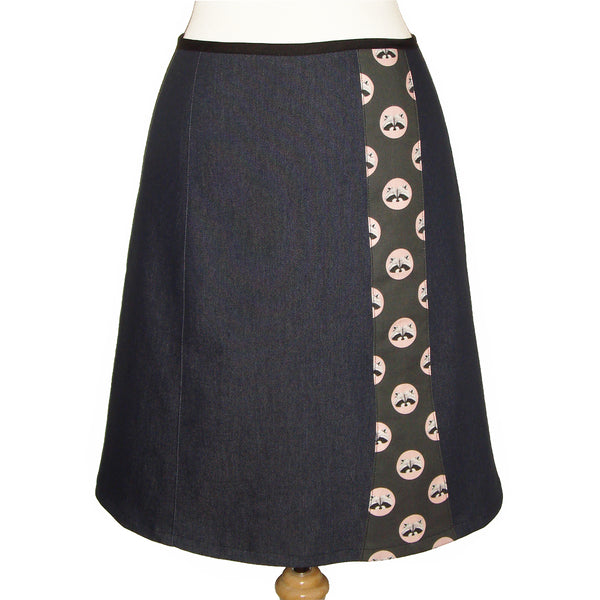 dark denim knee length skirt with polka dots and raccoon face print.