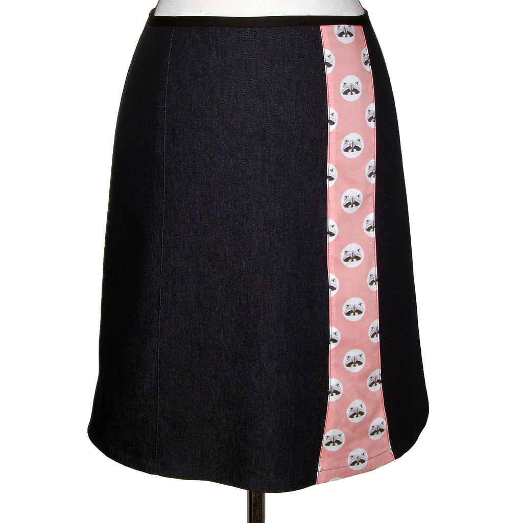 Dark knee length denim skirt with stripe of fun cotton printed with polka dots and raccoon faces on a pink background