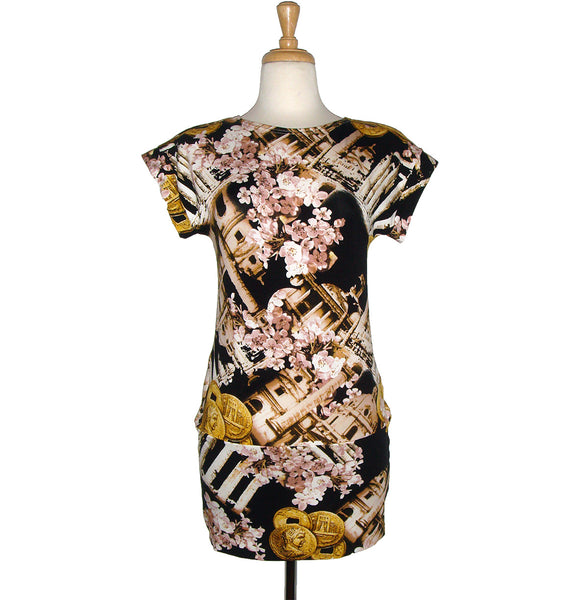 long tunic top with short sleeves in a beautiful print of ancient coins, columns, and cherry blossoms over black background.