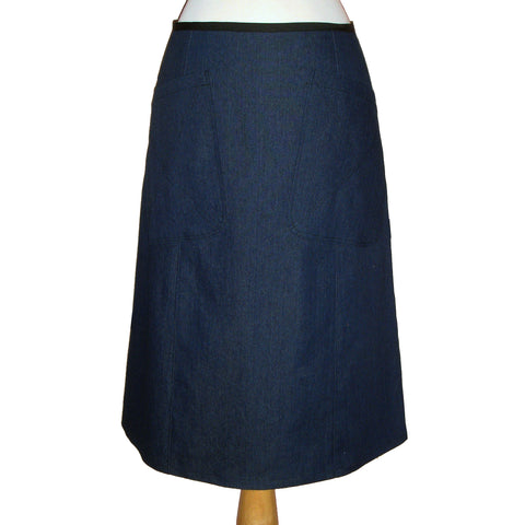denim midi skirt in blue, with large patch pockets on the front, 70's style.
