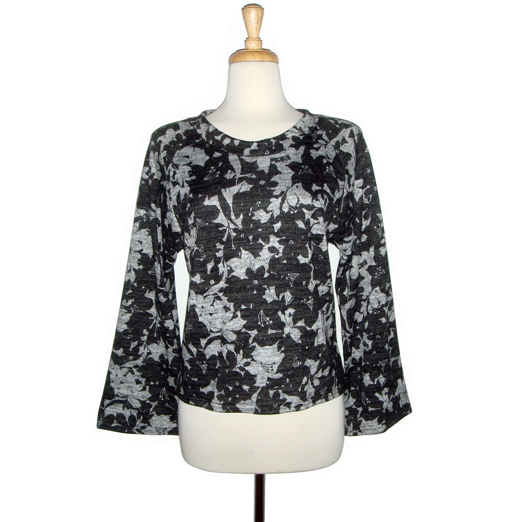 Beautiful floral knit sweater in a black and grey print with raglan sleeves.