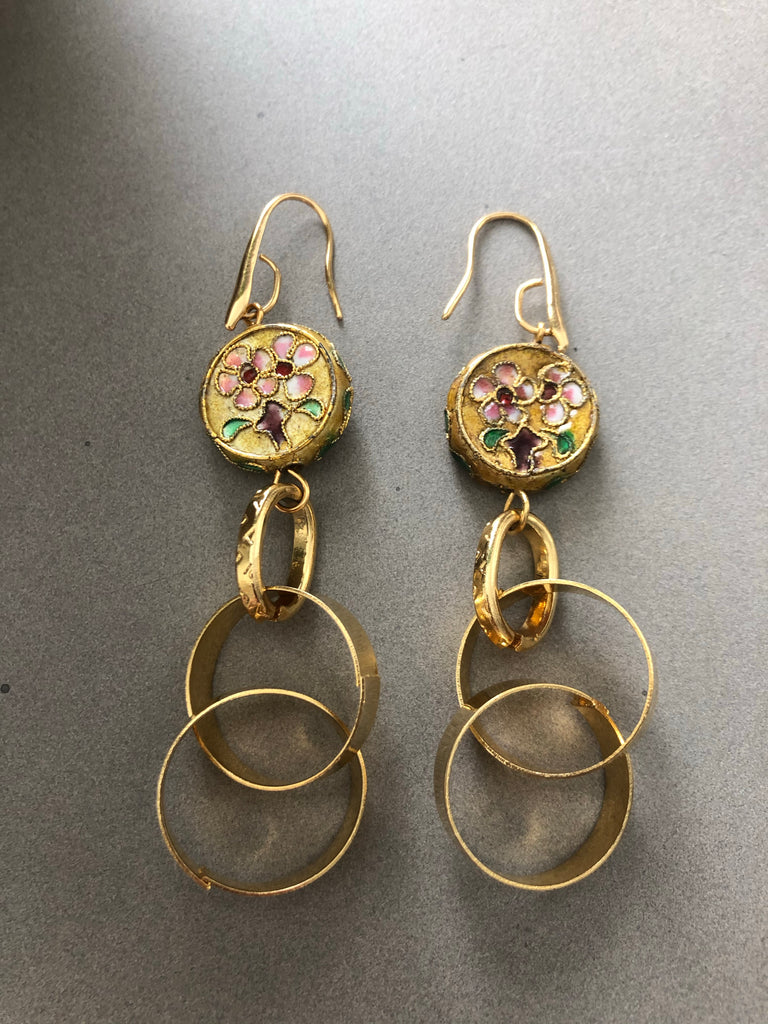Gold chain earrings with metal beads decorated with flowers