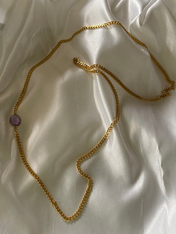Gold chain necklace with a crystal