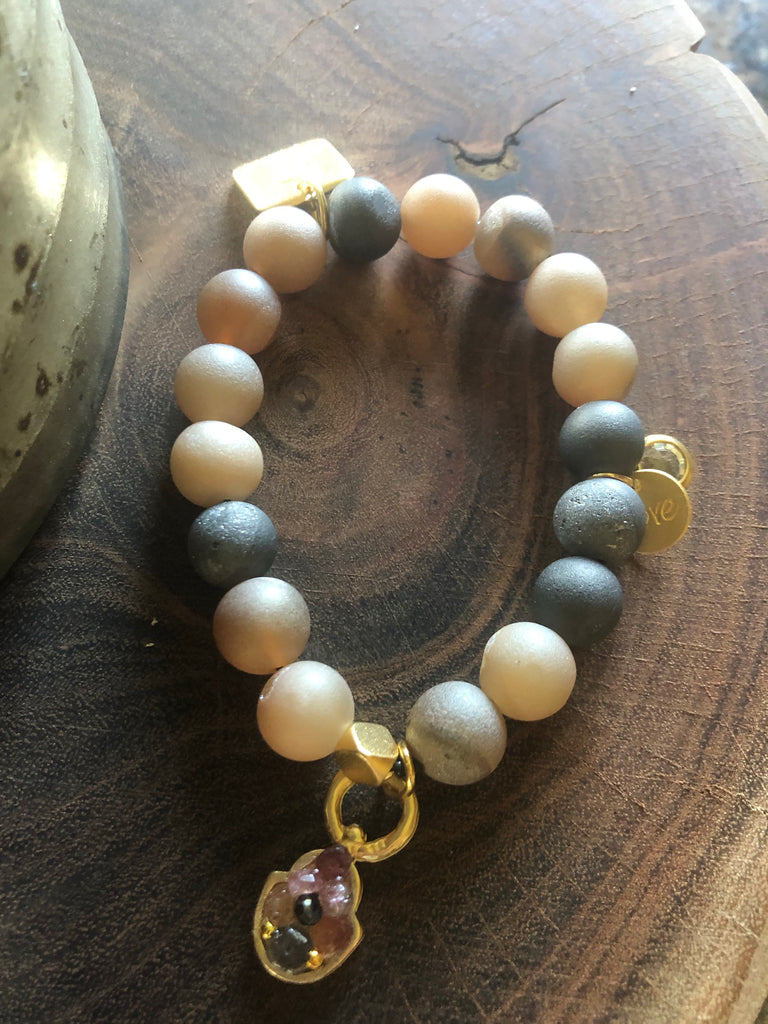 Druzy Quartz bracelet with gold Hamsa decorated with gemstones