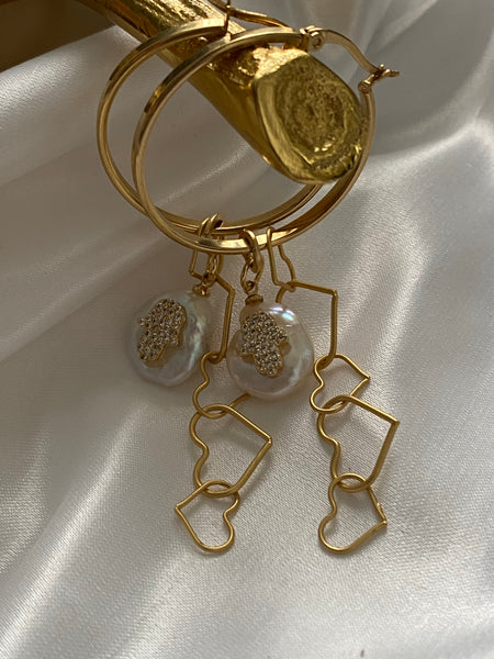 Gold hoop earrings with gold hearts chain with a pearl charm and a crystal hamsa