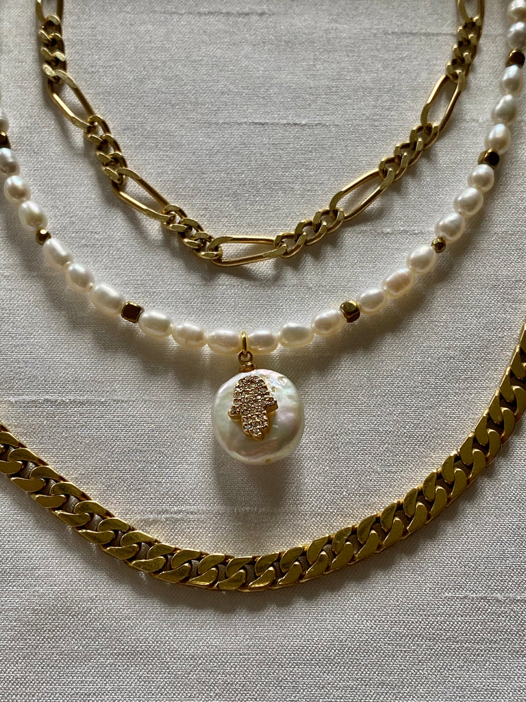 Pearl choker necklaces with Hamsa on a pearl