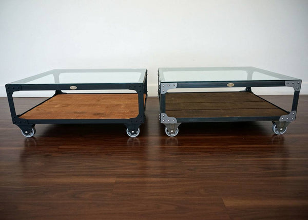 Metal and wood coffee table on casters