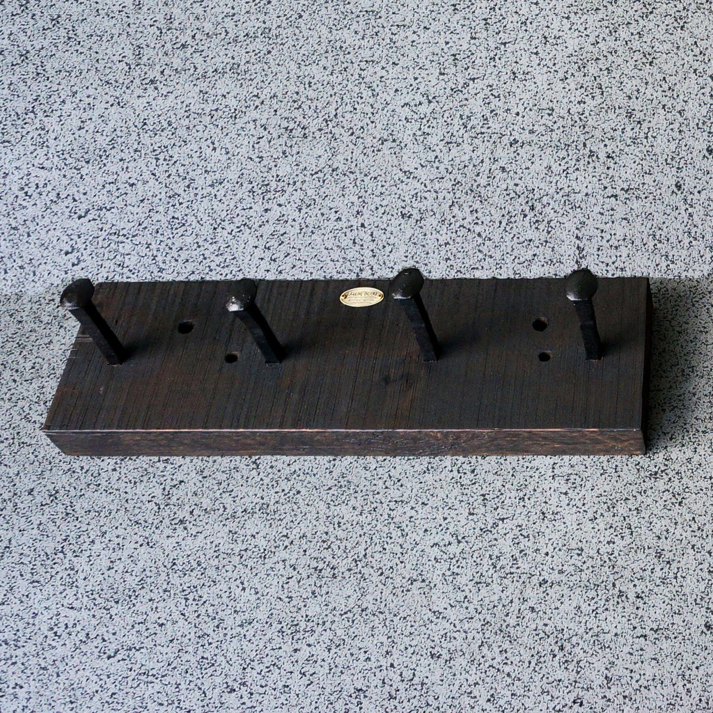 Railroad spike coat rack for condo or loft