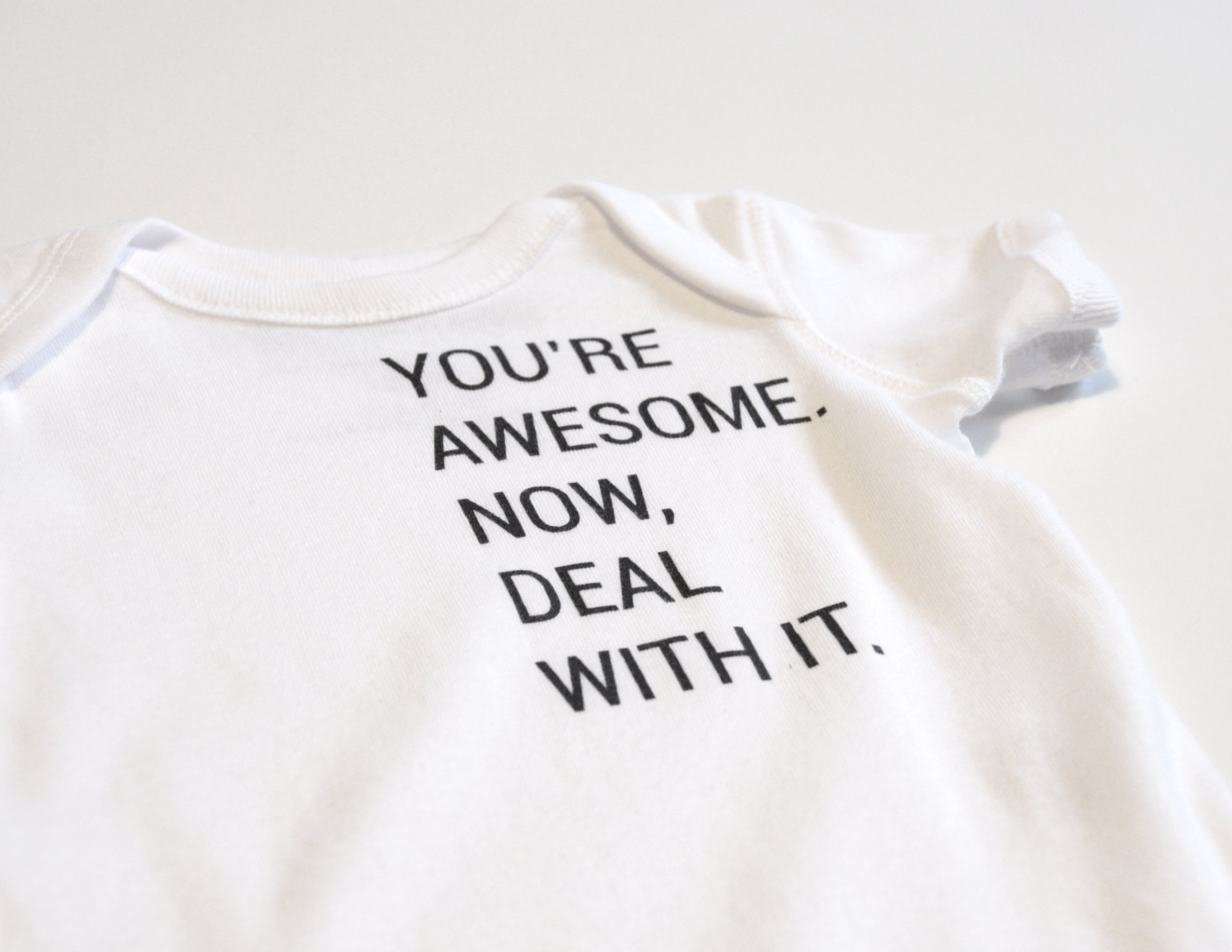 YOU'RE AWESOME. NOW DEAL WITH IT. // Cache-Couche Blanc Enfant // White Onesie