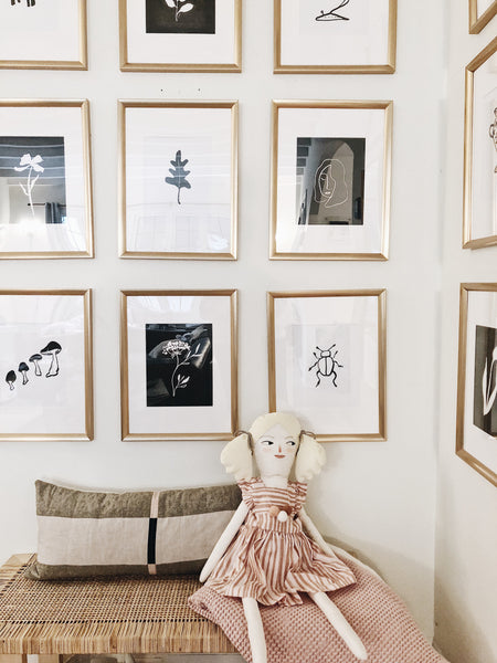 085b8e3a332 This is the gallery wall I recently designed in my living room. I opted for  gold vintage frames that bring my hand-drawn prints to life.