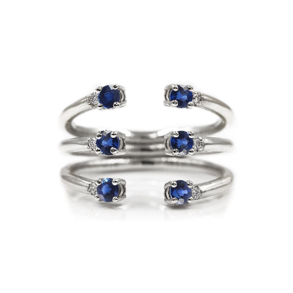 The Ally 14k whitegold diamond ring, blue sapphire, open design.