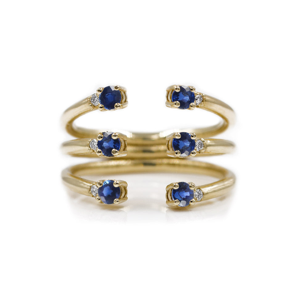 The Ally 14k yellowgold diamond ring, blue sapphire, open design.