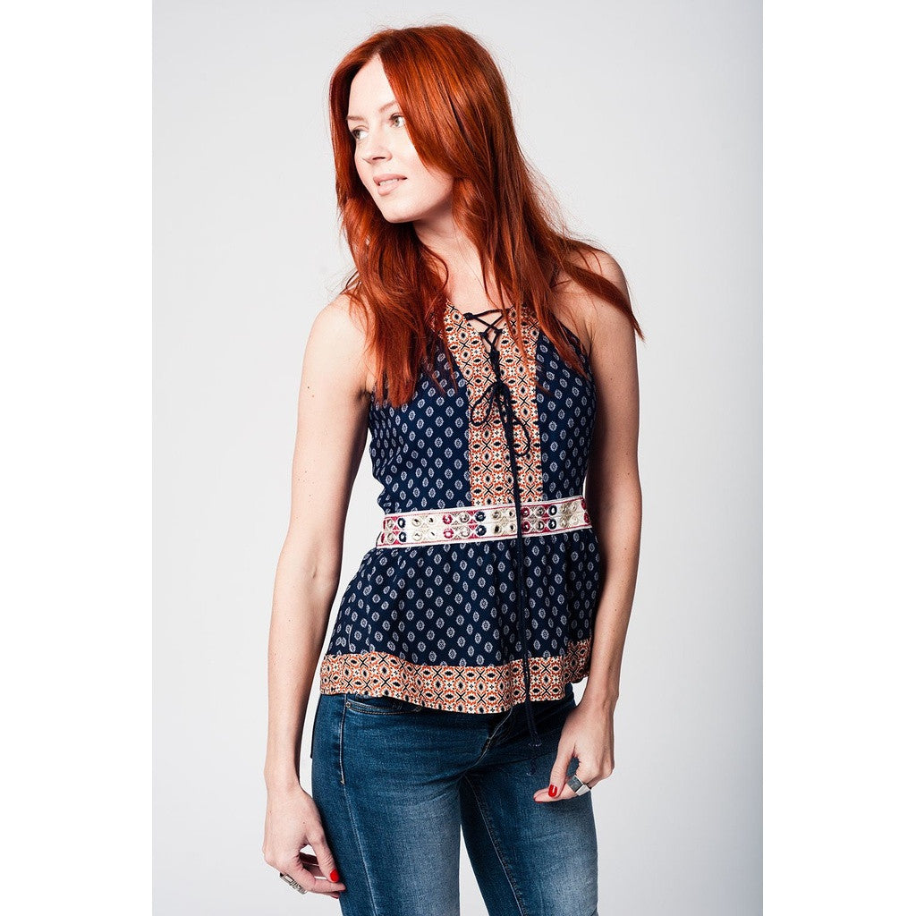 Printed navy top with lacing at the neckline and embroidery detail at the waist