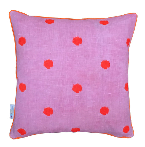 Neon orange spots on pink linen cushion cover