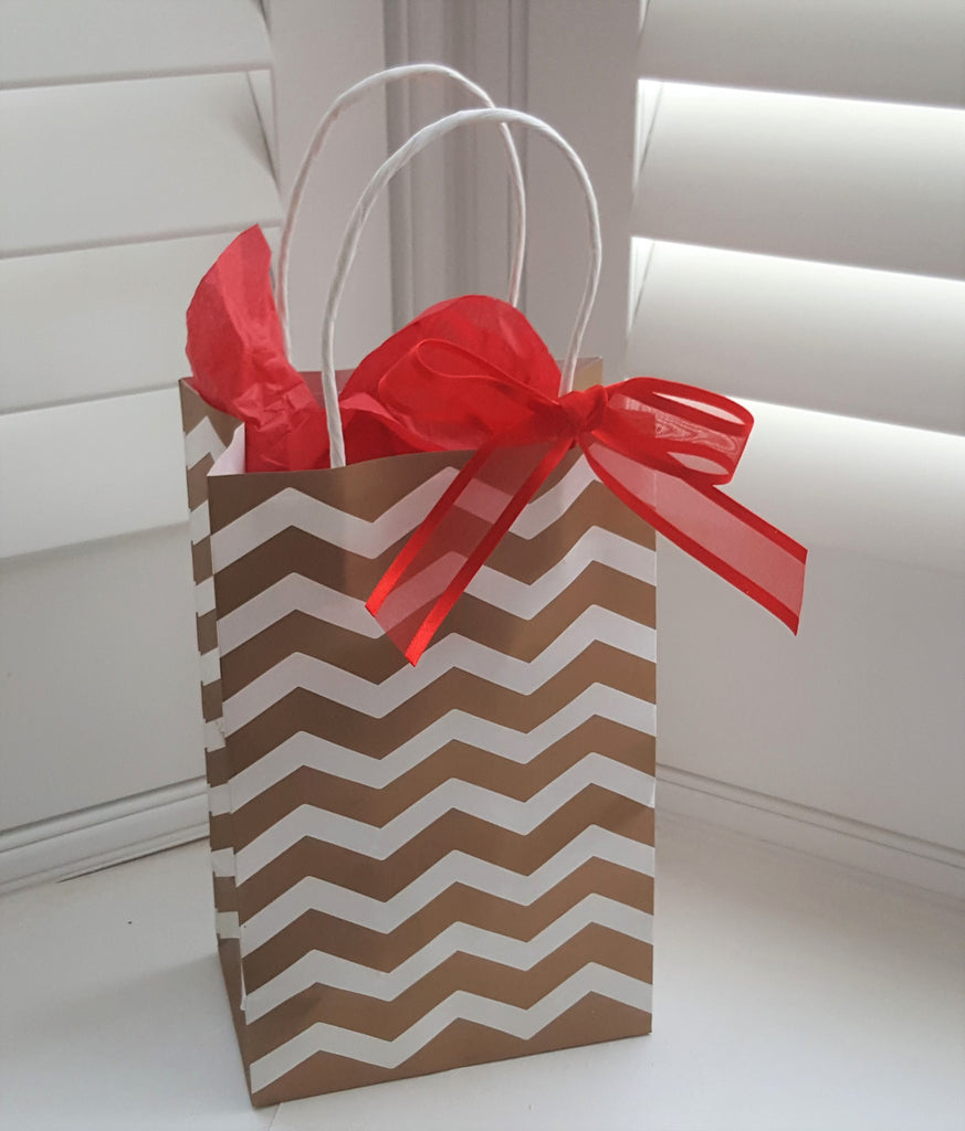 Gold and White Chevron Striped Gift Bags with Red Ribbon - The Party Postman