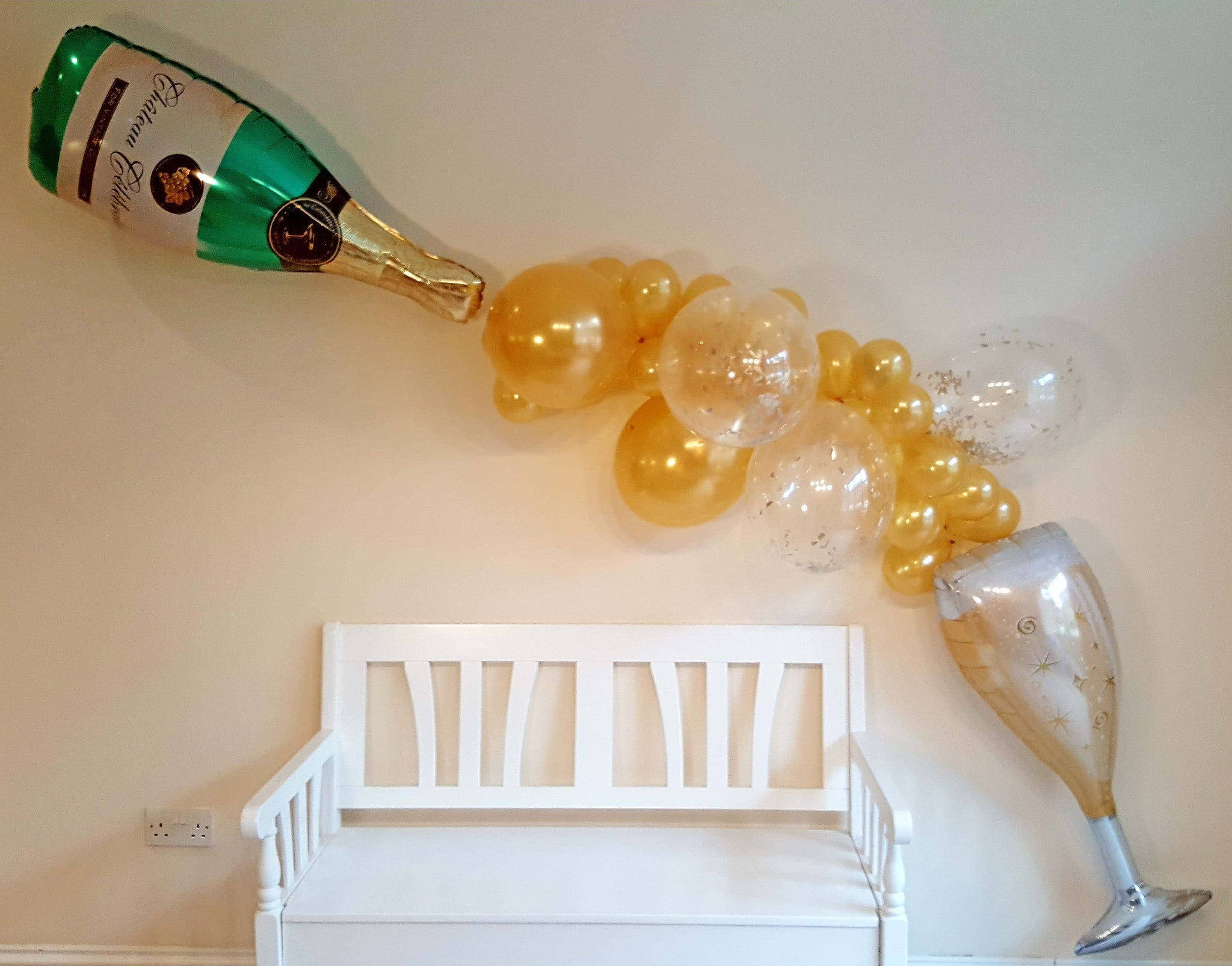 Champagne and wine gold balloon garland the party postman for Champagne balloon wall