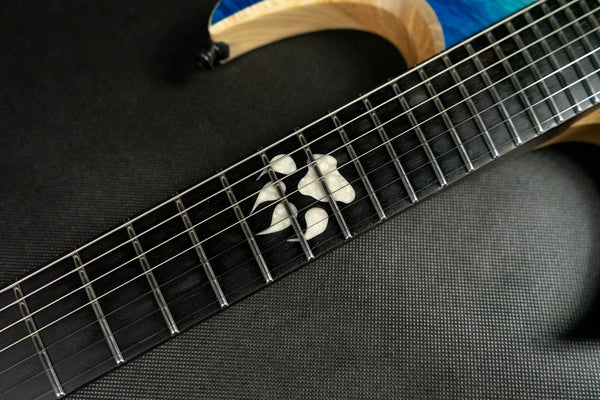 BlacKat DC7 Multiscale:  Maple Burlover Black Euro Ash.  Ebony Fretboard.