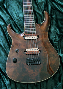 BlacKat Electric Guitar. DC 7 String Walnut Carved Top