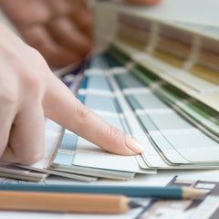 Choosing paint colours from a colour chart