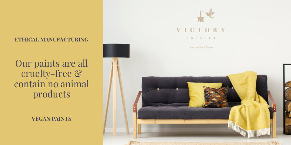 Victory Colours Cruelty Free & Vegan Paint Gossamer White with Yellow Throw over Grey Couch