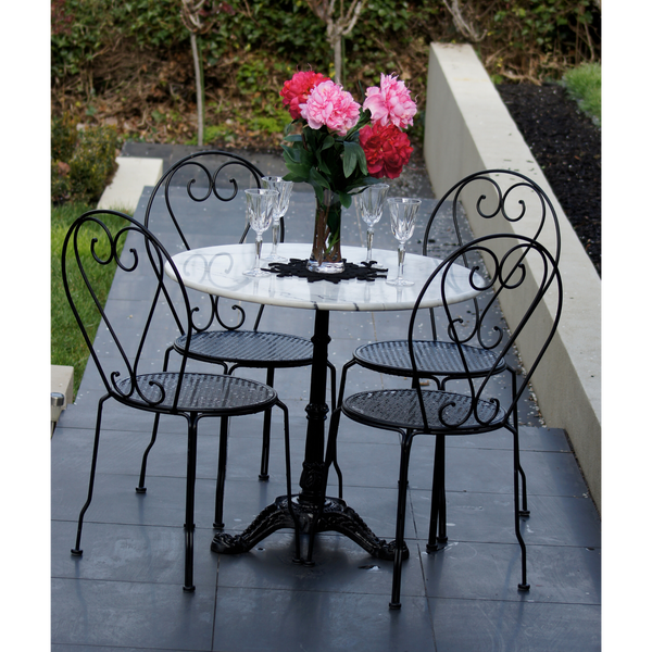 Outdoor patio setting Bella, marble top and cast iron base with 4 chairs in black. Pictured in garden setting
