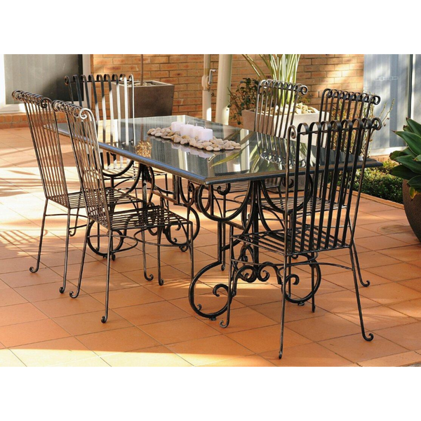 Outdoor Dining setting made from natural stone- Granite, 6 wrought iron dining chairs- Emily style and solid iron table base. Pictured in a courtyard, garden setting.