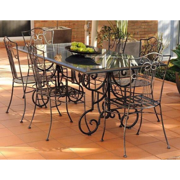 Outdoor Dining setting made from natural stone- Granite, 6 wrought iron dining chairs- Sophie  style and solid iron table base. Pictured in a courtyard, garden setting.
