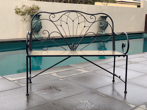Outdoor Derby bench seat in black made from metal, set around the pool