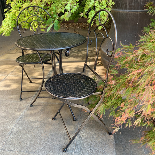Patio Setting - Gatsby Bronzed Black 3 Piece Metal Garden Setting in the garden up close of chair side view