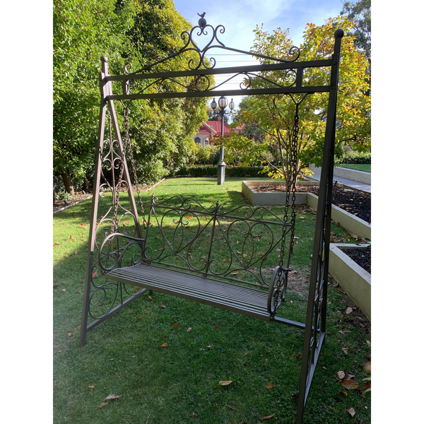 Outdoor Garden swing, made from metal in antiqued, aged brown finish, pictured in garden setting