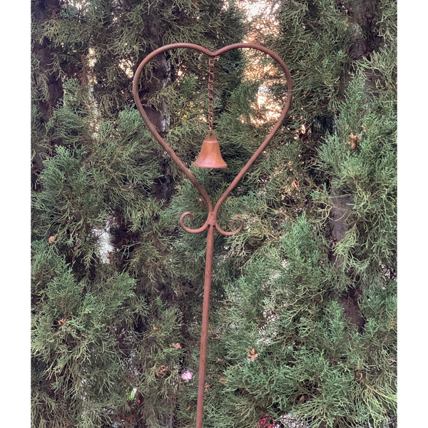 Metal Garden Stake Heart Bell - Rust in garden