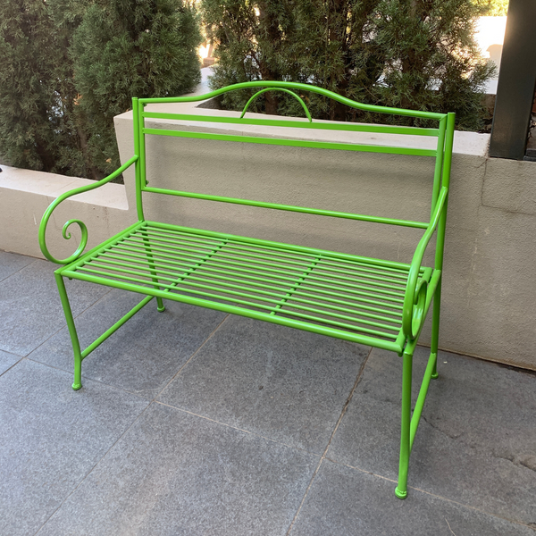 Outdoor garden bench Salsa, Made from metal in lime green colour, pictured on paving