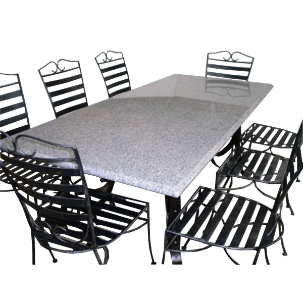 Outdoor Dining setting made from natural stone- Granite, 6 wrought iron chairs and solid iron table base. Pictured in a courtyard, garden setting.