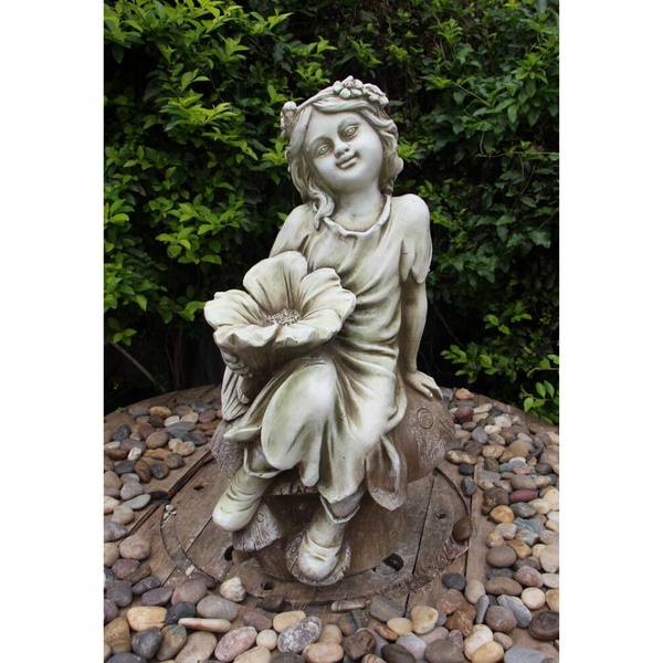 Statue - Fairy on Mushroom Bird Feeder in the garden