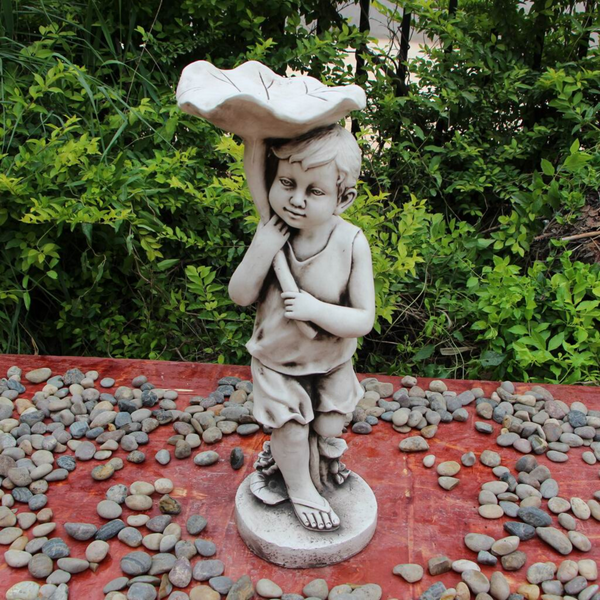 Statue - Boy Bird Feeder Bath Sculpture in the garden