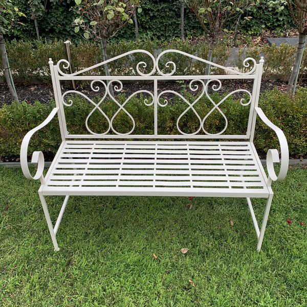 Outdoor garden bench Zara, made from metal, in cream colour, pictured in garden setting