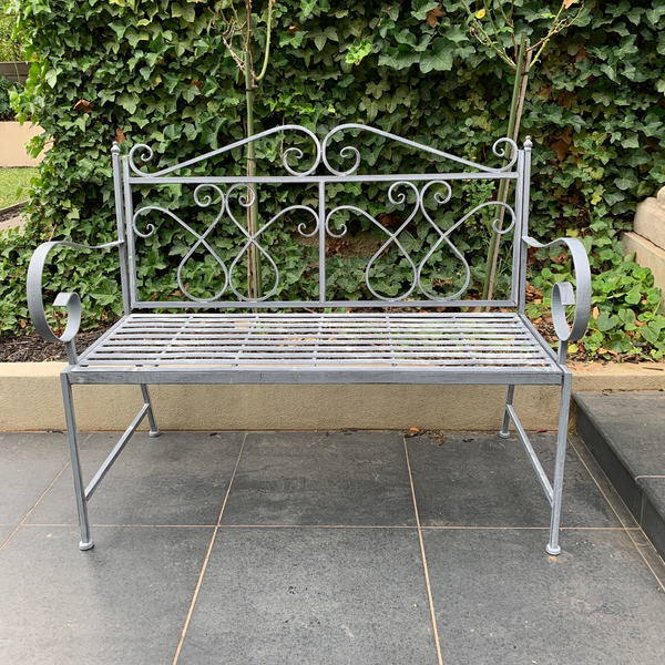 Outdoor garden bench Zara, made from metal, in grey with white wash colour, pictured in garden setting