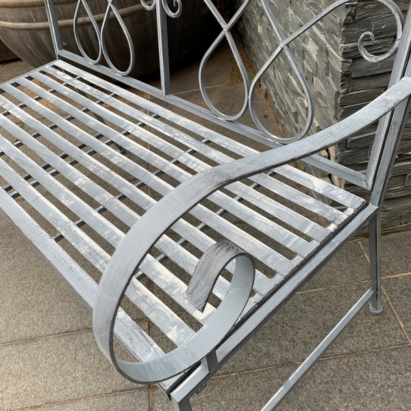 Outdoor garden bench Zara, made from metal, in grey with white wash colour, pictured close up of arm & seat