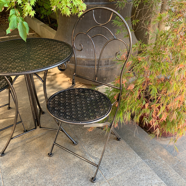 Patio Setting - Gatsby Bronzed Black 3 Piece Metal Garden Setting in the garden up close of chair