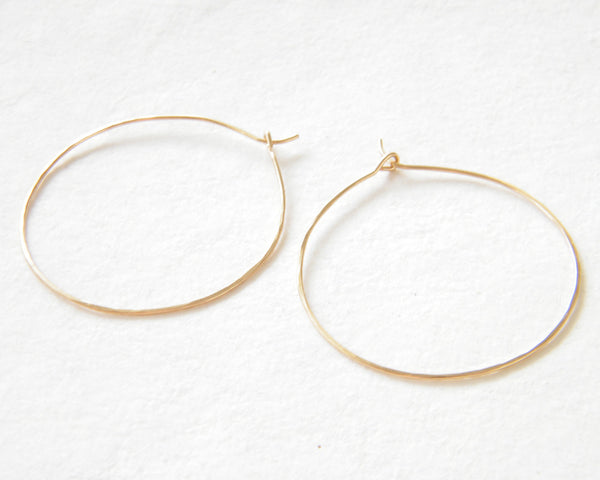 Hammered hoop earrings.