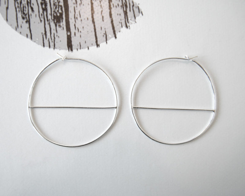 Divided hoop earrings.
