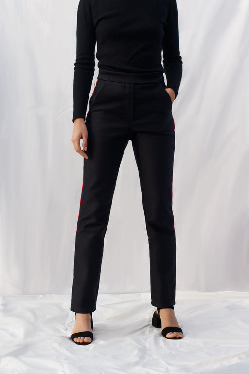 Front View of Organic Cotton Black Women's Milli Pants by Natasha Rose with Red Side Stripes