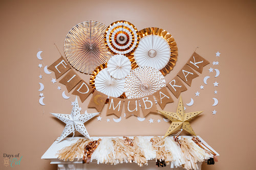 Gold and white garlands and Eid mubarak banner