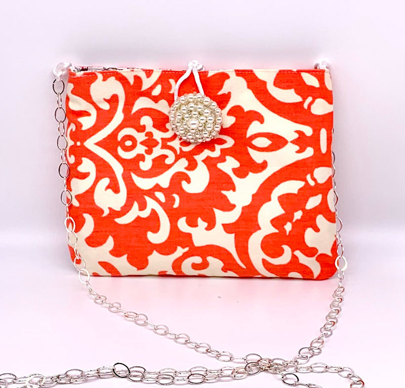 #867 - Coral Icat and Floral Switch Purse