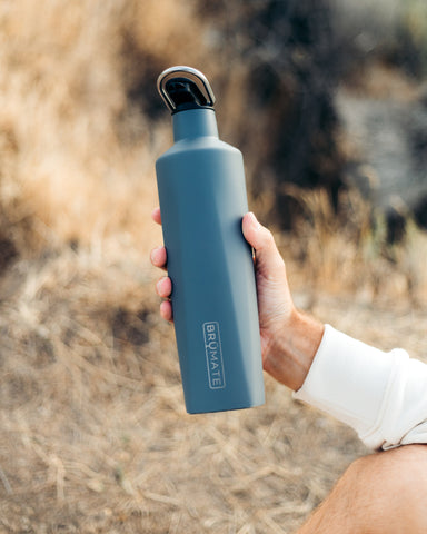 person holding water bottle.