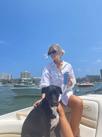 woman with dog on a boat.