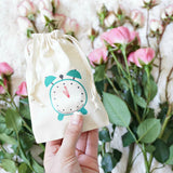A day of presents with clock bags inside The Bridesmaid Mini Gift Box