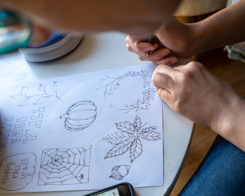 A piece of paper being sketched on