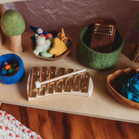 Pentatonic glockenspeil on a shelf with Waldorf toys and wooden toys
